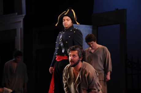 Javert (L- Renwick Anson Paige II) and Jean Valjean (JP Sisneros). Photo courtesy of Montgomery College Summer Dinner Theatre.