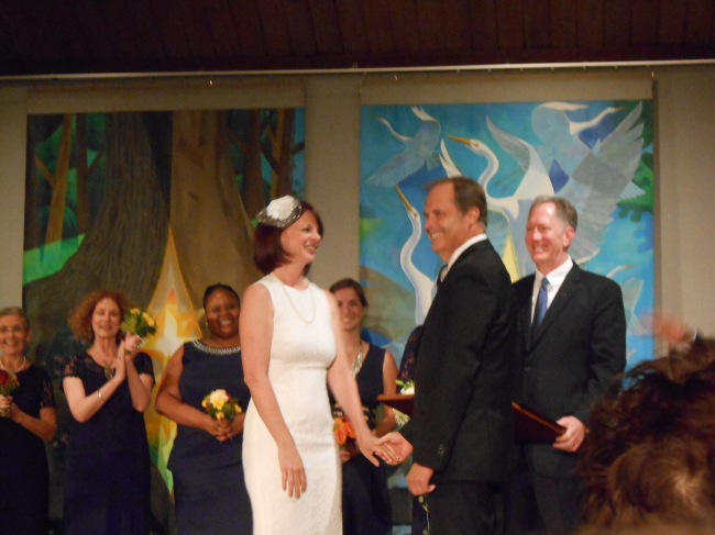 "Actual bride Janet Luby (left) and her actual groom Steven Strawn (right) preparing to say ""I Do"" in front of the entire audience of the staged reading."